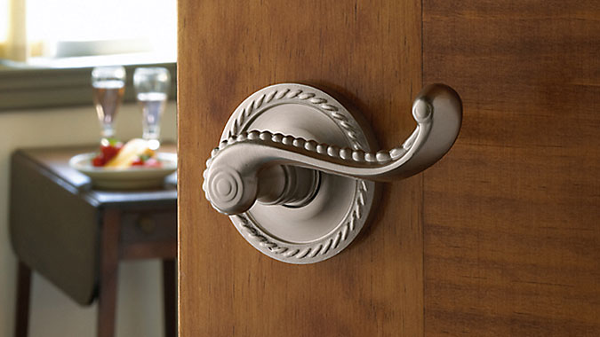 A traditional federal style lever with optional rose in satin nickel is part of the Estate Portfolio from Baldwin Hardware