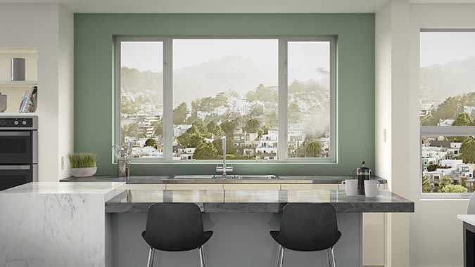 The clean lines and modern design of Milgard Aluminum Windows compliments this kitchen with views of the city
