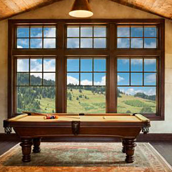 Milgard Essence Series wood windows in this game room with pool table