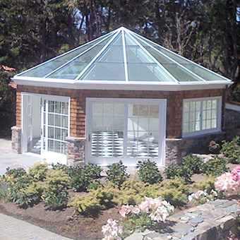 Royalite fabricated this octagon solarium with a pyramid glass roof making it the perfect addition to the garden