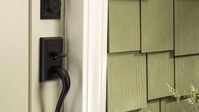 This front door is classically simple and features the Schlage Addison handleset in matte black with subtle detailing