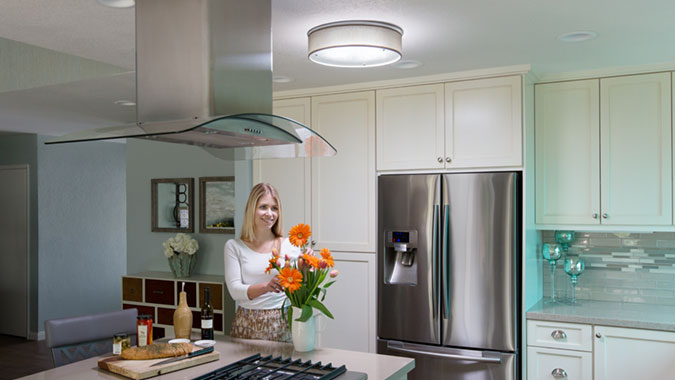 The daylighting system by Solatube installed in this kitchen features a decorative VividShade for even, natural light