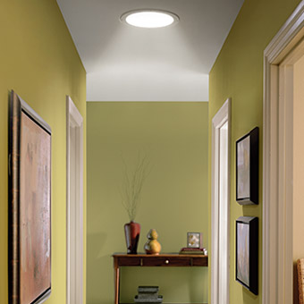 Even on the cloudiest days this hallway stays bright with natural light from the Velux Sun Tunnel Skylights
