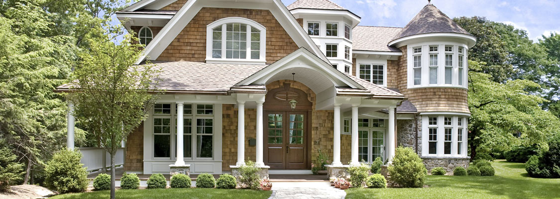 The classic look of Jeld-Wen AuraLast wood windows and patio doors with exterior cladding, Colonial grilles and Low-E glass surround this VIctorian estate
