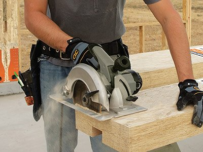 Contractor using a circular saw to field trim a Simpson Strong-Wall shearwall at the jobsite