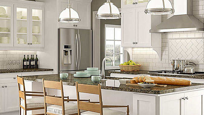 The Current line of custom cabinetry is featured in Simply White in this upscale kitchen design