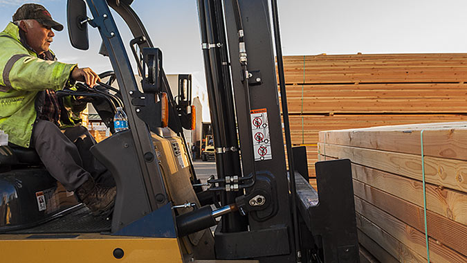 Forklift driver with Douglas Fir 4x6 load