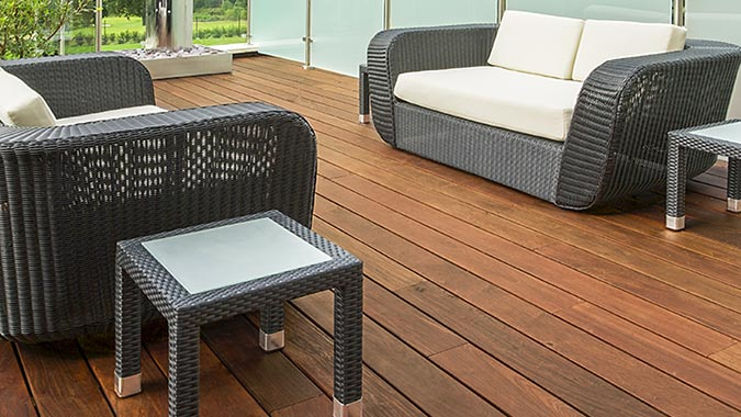 This outdoor living space includes a deck built from Ipe hardwood decking