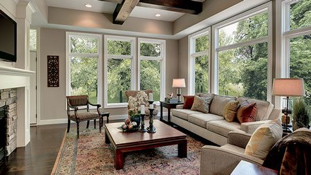 Integrity Wood-Ultrex casement and large picture windows are featured in this luxury homes living room