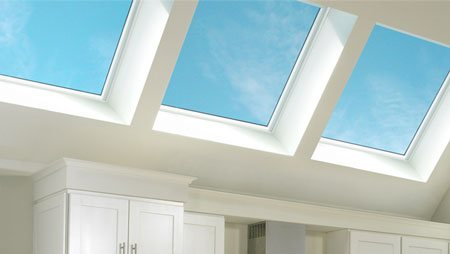 A group of Velux skylights positioned over the work area provide abundant, even daylight to the entire kitchen